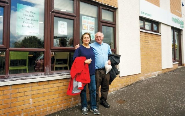 Howard and Claire Singerman stand outside Mark's Deli, a Jewish restaurant in Glasgow, on July 4. (Cnaan Liphshiz)