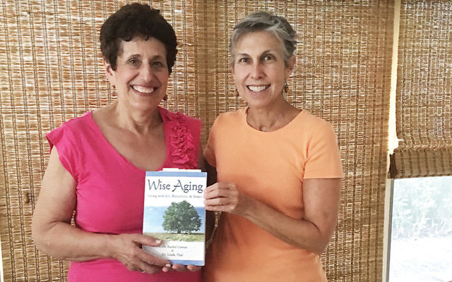 "Dr. Elaine Cohen, left, and Dr. Rochel David hold a copy of the book they're using in their ""Wise Aging"" course."