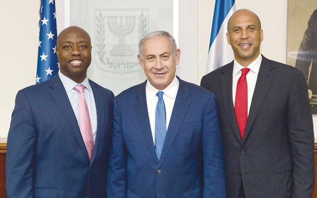 U.S. Senators Tim Scott (R-S.C.) and Cory Booker (D-N.J.) stand with Israeli Prime Minister Benjamin Netanyahu.