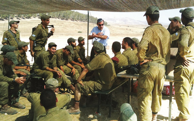 Rabbi Hammer with soldiers in the field.