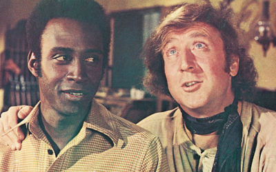 """Gene Wilder, right, and Cleavon Little in the 1974 Mel Brooks comedy """"Blazing Saddles.""""  (Warner Bros./Courtesy of Getty Images)"""