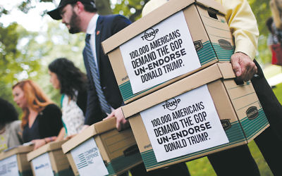 Former members of the U.S. military carry boxes in Washington, D.C., on August 4 with more than 100,000 signatures requesting that Senator John McCain (R-Ariz.) and other Republican leaders withdraw their endorsement of presidential candidate Donald Trump. (Win McNamee/Getty Images)