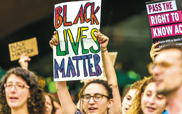 The Jewish community in New York holds a rally for the Black Lives Matter movement outside the Barclays Center in Brooklyn on July 28. (Erik McGregor/Pacific Press/LightRocket via Getty Images)
