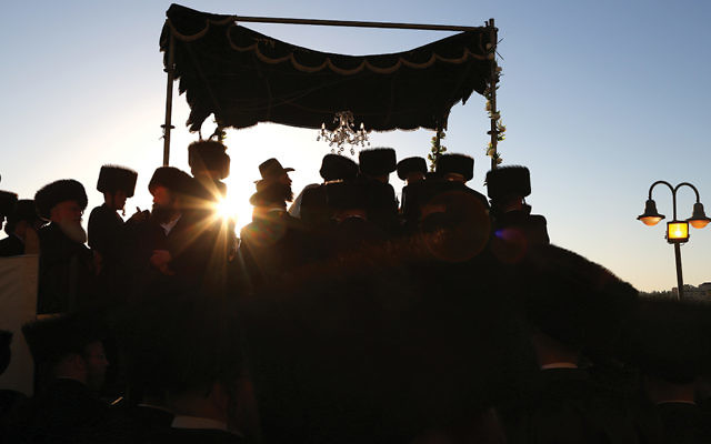 Chasidic men celebrate a wedding in Israel, where marriage and divorce are legally under the authority of the Orthodox chief rabbinate. (Yaakov Lederman/Flash90)