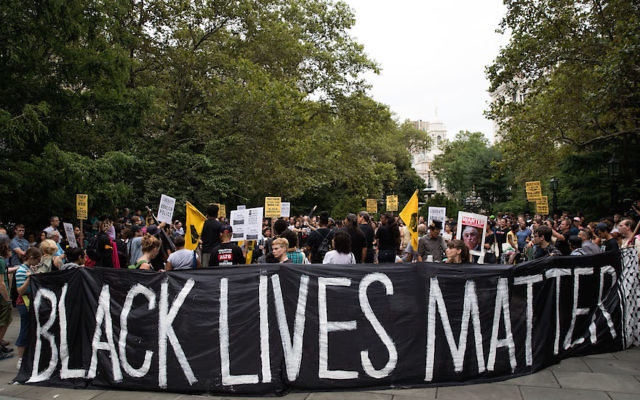 NEW YORK, NY - AUGUST 1: Protestors rally during a protest against police brutality at City Hall Park, August 1, 2016 in New York City. The protest was organized by Millions March NYC, who are calling on Mayor Bill de Blasio to fire NYPD Commissioner Bill Bratton and end 'broken windows policing.' The group is claiming they will stay in City Hall Park until their demands are met. (Photo by Drew Angerer/Getty Images)