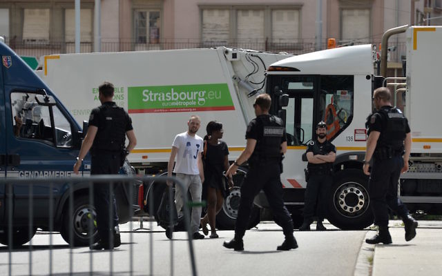 A garbage truck blocks the traffic as policemen control the access to the city center of Strasbourg, eastern France, on July 30, 2016, during the traditional Braderie (street market).  / (Photo credit should read PATRICK HERTZOG/AFP/Getty Images)
