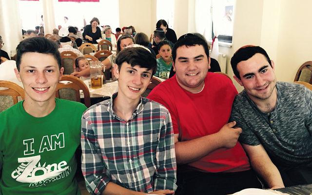 Shimmy Mandelbaum, CJ Glicksman, Eli Kahn, and Jason Blatt taught Hebrew and learned about Jewish identity in Poland. (Tova Rosenberg)