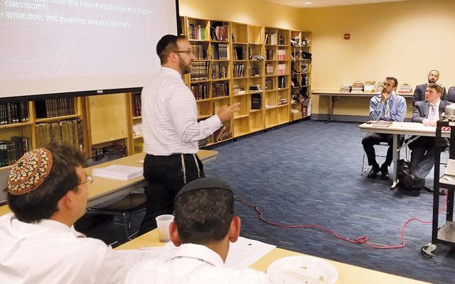 Rabbi Asher Yablok addresses TABC staff.