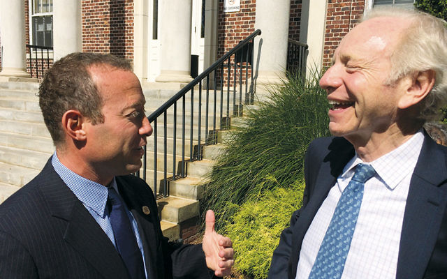 Josh Gottheimer, Democratic candidate in the 5th Congressional District, chats with former Senator Joseph Lieberman after receiving his endorsement. (Photos by James L. Janoff)