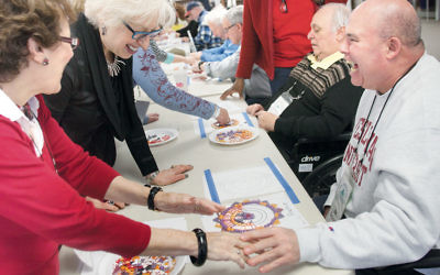 Participants make a mosaic at the Adler Aphasia Center.