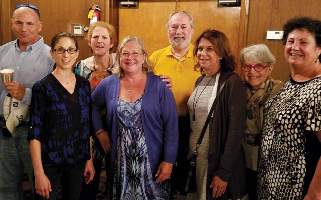 B'nai Jacob alumni, from left, Dean Brody, Lauren Weinberg, Phyllis and Mark Harris, Beth Chananie, Sherrie Levine Staszewski, Jane Canter, and Lynn Millinger.
