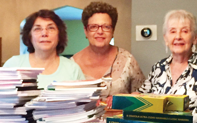 From left, Ruth Seitelman and Barbara Berger-Brill, NCJW BCS vice presidents of community service, and presidium member Marcia Levy pack school supplies for children in need. (Courtesy NCJW BCS)