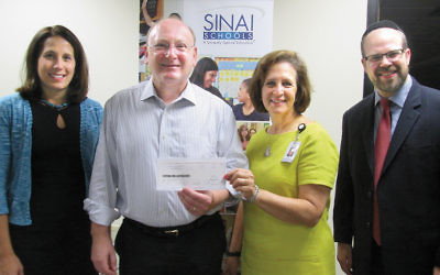From left, Cedar Wang, Holy Name Medical Center's director of simulation education; Sinai School's managing director, Sam Fishman; Deborah Ross, Holy Names' nursing informatics specialist, and Sinai's dean, Rabbi Yisrael Rothwachs. (Courtesy Sinai)