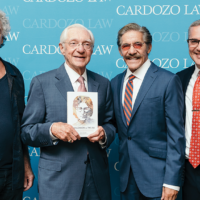 """Bob Gruen, left, with Leon Wildes, Geraldo Rivera, and former Englewood mayor Michael Wildes, who is also Leon Wildes' son and law partner, at a recent launch for Leon's new book, """"John Lennon vs. The USA."""" Mr. Rivera, Mr. Gruen, and Carol and Mark Lapidos, founders of Fest for Beatles Fans, were among the guests at the party, held at the Benjamin Cardozo School of Law in Manhattan. Yoko Ono was a co-host. (Photo provided)"""
