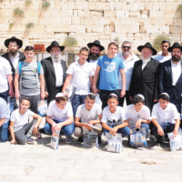 Bris Avrohom recently held its seventh annual bar mitzvah celebration in Israel for young people from Be'er Sheva and Sedorot. All have been victims of terror and all come from the former Soviet Union. Rabbi Nosson Kanelsky, the father of Rabbi Mordechai Kanelsky, Bris Avrohom Hillside's executive director, is fourth from the left. (Courtesy Bris Avrohom)