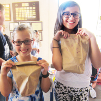 Religious school students from Shomrei Torah in Wayne packed breakfast bags for CUMAC in Paterson, the largest food distribution program in Passaic County. The shul's teens will deliver them when they volunteer there next week. (Courtesy Shomrei Torah)