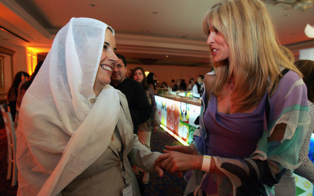 Marla Maples, right, the ex-wife of Donald Trump, speaking with Dalila, the wife of Druze Sheikh Abu-Ruchon Hussein, at the Kabbalah international conference in Tel Aviv, Sept. 19, 2004. (Heidi Levine/ Pool/ Getty Images)