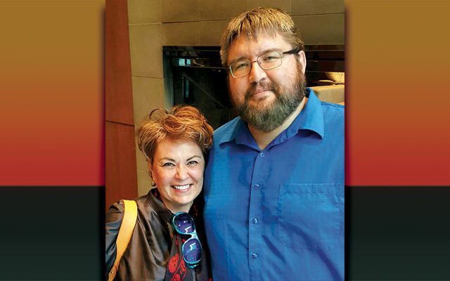 Ryan Bellerose, who founded a pro-Israel organization before taking the B'nai Brith job, stands with actress Roseanne Barr. (Courtesy of Bellerose)