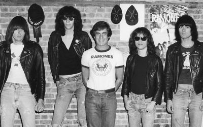 Danny Fields, center, with the black-jacketed Ramones. (Courtesy of Magnolia Pictures)