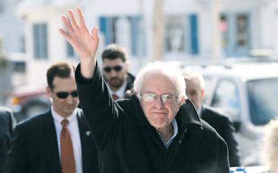 Sen. Bernie Sanders (I-Vt.) waves on New Hampshire primary day in Concord on February 16. (Spencer Platt/Getty Image)