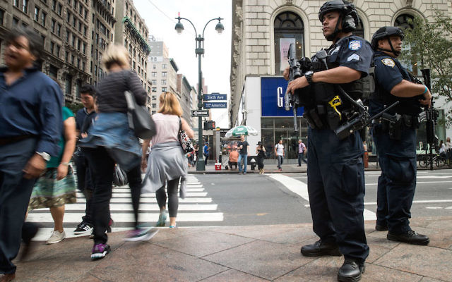 Members of the New York City Police Department standing guard in Manhattan's Herald Square, near where a bomb was set off the previous evening, Sept. 18, 2016. (Drew Angerer/Getty Images)