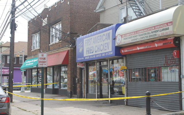 First American Fried Chicken, which is owned by the family of Ahmad Khan Rahami, was closed and cordoned off a day after he was arrested for a series of bombings in New York and New Jersey, Sept. 20, 2016. (Ben Sales)