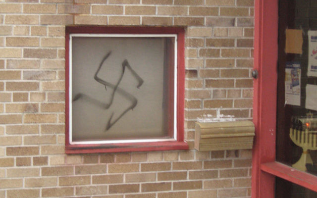 Prosecutors say that Aakash Dalal directed this vandalism at Temple Beth El in Hackensack while he was in New Hampshire.
