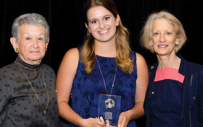 Valerie Weisler accepts her award at the JCF luncheon. She's flanked by representatives of the Diller Foundation, Adele Corvin, left, and Susan Epstein.
