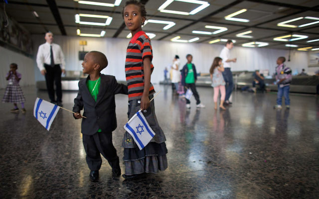 New Jewish immigrant children after arriving on a flight from Ethiopia, at Ben Gurion Airport near Tel Aviv, Israel, Oct. 29, 2012. (Uriel Sinai/Getty Images)