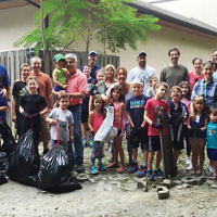 """Temple Emanu-El of Closter joined """"Nature Marc"""" of the Closter Nature Center for a mitzvah project to help clean up the natural habitat surrounding the synagogue. (Courtesy Emanu-El)"""