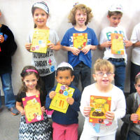Religious school students from Shomrei Torah in Wayne show cards they made for Rosh Hashanah. (Courtesy Shomrei Torah)