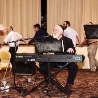 More than 200 people came to the Selichot musical program at the Jewish Center of Teaneck, where, from left, Elisha, Zalmen, and Rabbi Avram Mlotek performed. Zalmen Mlotek of Teaneck, who was joined by his sons, is the artistic director of the Folksbiene, the National Yiddish Theater. A drasha by the shul's new rabbi, Daniel Fridman, and services followed. (Photo by Michael Laves)