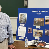 Holocaust survivor Bernie Gola, 89, pictured, and his wife, Bernice, who live in Washington Township, spoke to sixth graders at Valley Chabad's Hebrew School. Mr. Gola showed the tattoo on his arm — #B-3078 — given to him at Treblinka. He came to the United States penniless, and built a successful uniform business in Paterson that is still run by his family. (Courtesy Valley Chabad)