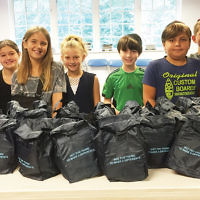Students at Temple Emanu-El of Closter packed snacks to donate to the Center for Food Action in Englewood. (Courtesy Emanu-El)