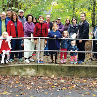 Members of Temple Emanuel of the Pascack Valley held their annual Tashlich service at Wood Dale County Park in Woodcliff Lake. The ceremony was led by Rabbi Loren Monosov, fourth from right, shown with her husband, Jeremy, and their two daughters in front of them. Cantor Alan Sokoloff blew the shofar at the end of the service. (Courtesy TEPV)