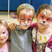 Ben Porat Yosef held its Family Fun Carnival on September 25. Activities included face painting, games, making lanterns for their sukkahs, bounce house, blow up rides, comedy juggling by Amazing Larry, and a petting zoo. (Courtesy BPY)