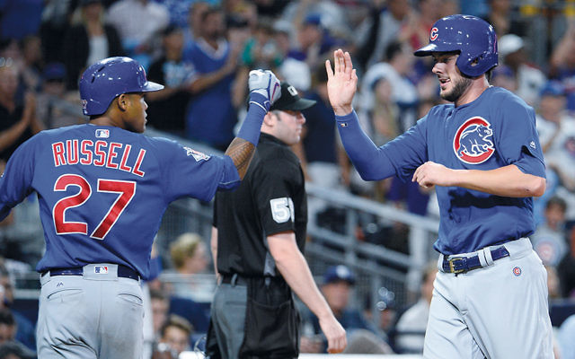 Cubs Addison Russell, left, and Kris Bryant during the fifth inning of a game against the Padres at Petco Park in San Diego on August 23. (Denis Poroy/Getty Images)