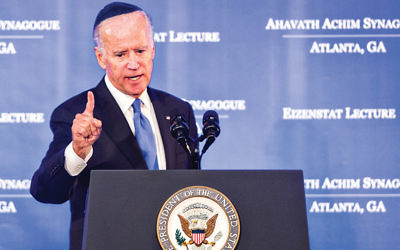 Joe Biden speaking in an Atlanta synagogue in September. We were unable to find a picture of Hillary Clinton wearing a yarmulke.