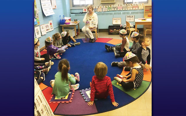 GrandPal Karen Albert reads to children in the early childhood program at Temple Emanuel of the Pascack Valley.