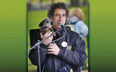 Murray Weinstock, composer and dog lover, with one of his friends.
