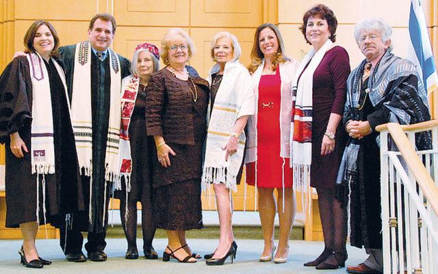 Rabbinic intern Lois Ruderman, left, with Rabbi Kenneth Emert, Laura Ashkenazi, tutor Judy Ackerman, Madeline Lakritz, Michelle Nemiroff, Sybil Duchin, and Cantor Ilan Mamber. (Courtesy CBR)