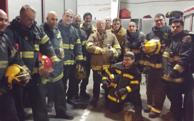 American and Israeli firefighters posing for photographs after returning from a call in Jerusalem, Nov. 27, 2016. (Courtesy of Emergency Volunteers Program)