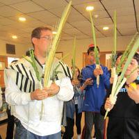Shomrei Torah religious school students marched around with lulavs and etrogs on Sukkot. (Courtesy Shomrei Torah)