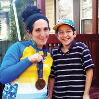 Rachel Zimmerman of Chicago, shown with her son, Nochy, who has Perthes disease and is supported by Chai Lifeline, all were part of Team Lifeline and ran in the New York City Marathon on November 6. Yossie Leff of Spring Valley, N.Y., and Florence Haut and Adam Sasouness, both of Englewood, were also on the 21-member team who ran for the children and families of Chai Lifeline. (Courtesy Chai Lifeline)
