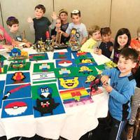 Children at Temple Emanu-El of Closter had fun building with Legos in the shul's sukkah. (Courtesy Emanu-El)