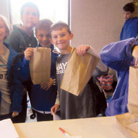 Shomrei Torah religious school students in Wayne packed donated toiletries for CUMAC. The nonprofit organization works to alleviate hunger for people in need in Paterson, Passaic County, and northern New Jersey. (Courtesy Shomrei Torah)