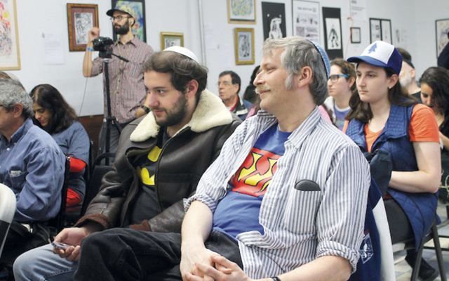 """The audience listens to a talk about """"Jewish Heroes and Villains"""" at the Jewish Comic Con in Brooklyn. (Photos by Ben Sales)"""