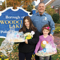 Kids pitch in Students ranging in age from tots to teens and their families baked cookies for first responders and veterans, created cheerful crafts and cards for hospitalized children, and assembled care packages for American soldiers. Here, Temple Emanuel of the Pascack Valley religious school students, deliver cookies to Woodcliff Lake's police department.