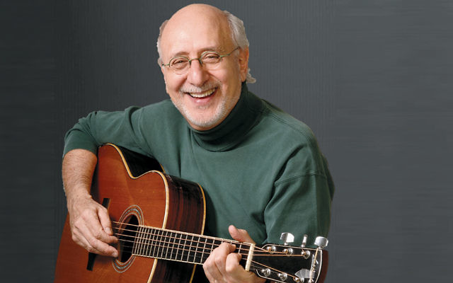 Peter Yarrow with his ever-present guitar.