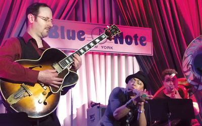 Matt Chertkoff, left, at the Blue Note in Manhattan, with vocalist Dee Dee Bridgewater and tuba player Clark Gaylon.
